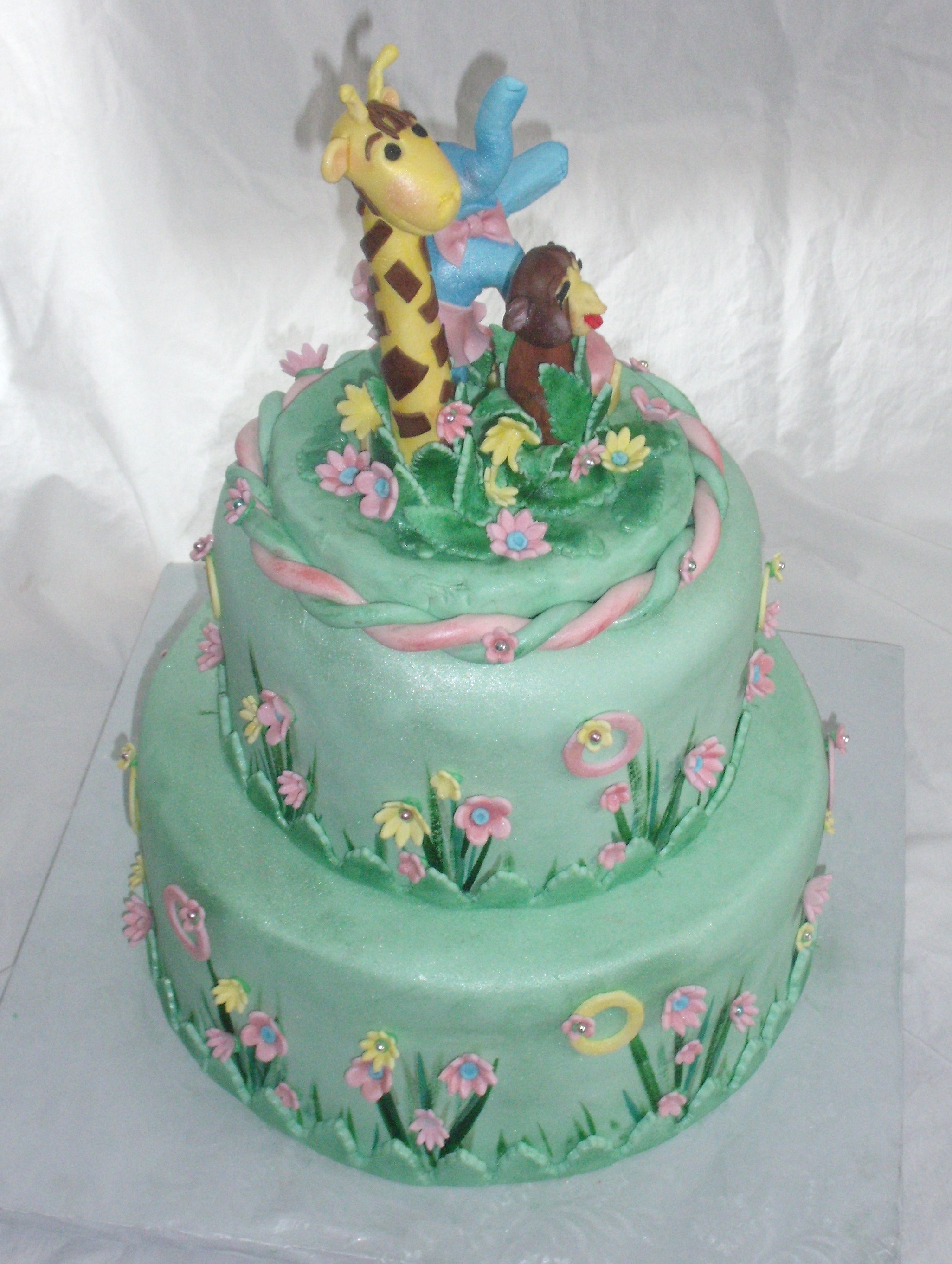 Safari Or Zoo Themed Green Pink And Yellow Baby Shower Cake With