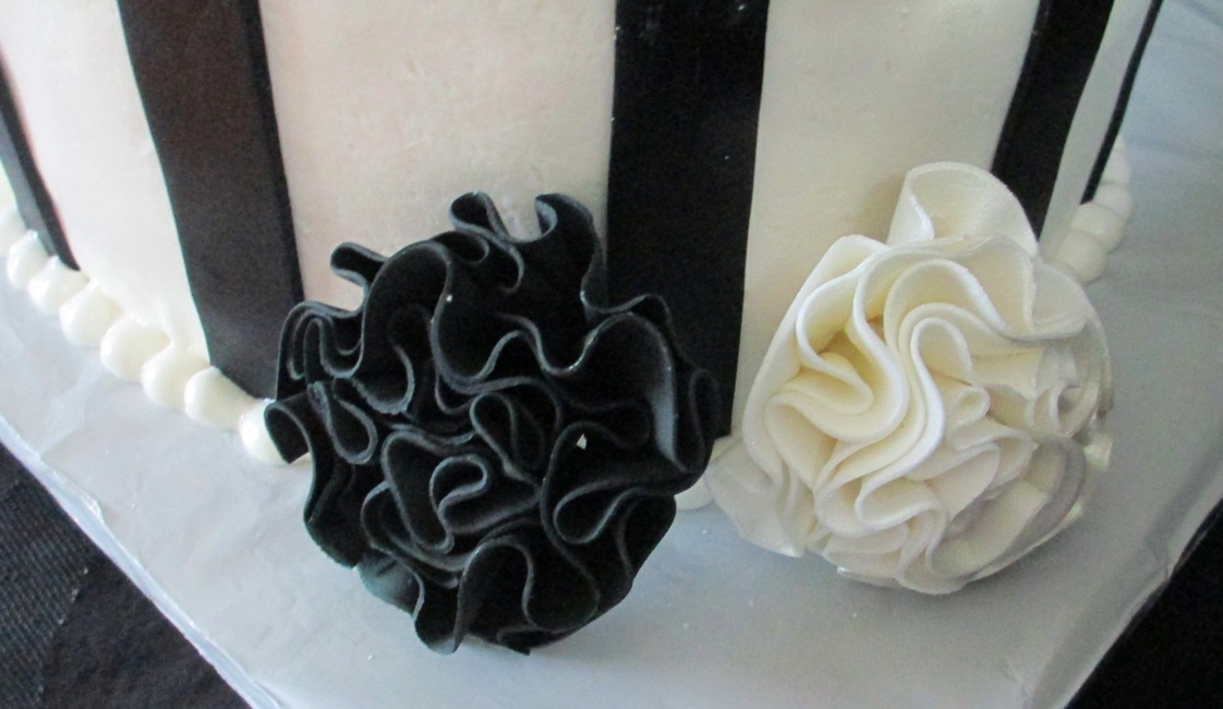 Whimsical topsy turvy black and white fondant cake with teal bow and whimsical black white fantasy gumpaste flowerclose up mightylinksfo