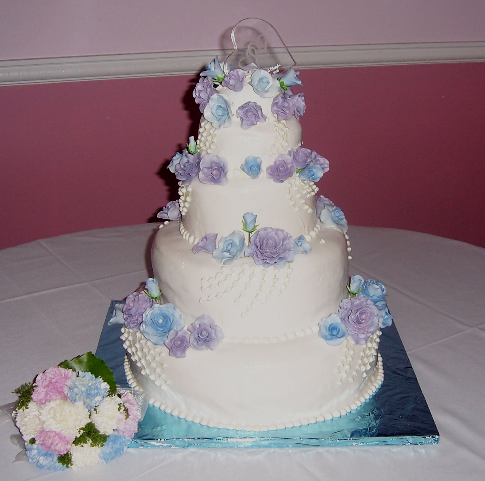 Valentina Wild\'s Wedding Cake With Pastel Blue and Pastel Purple Roses